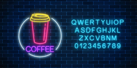 Neon glowing sign of coffee cup in circle frame with alphabet. Fastfood light billboard sign. Cafe menu item.
