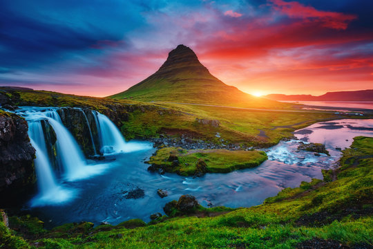 Fantastic evening with Kirkjufell volcano. Location famous place Kirkjufellsfoss waterfall, Iceland, Europe.