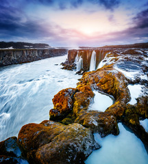 Rapid flow of water powerful Selfoss cascade. Popular tourist attraction.