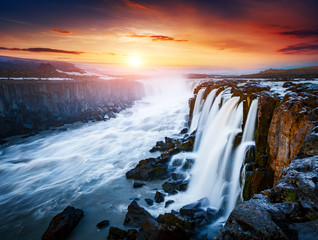 Rapid flow of water powerful Selfoss cascade. Unusual and gorgeous scene. Popular tourist attraction.