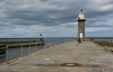 pier of port of Whitby with lightouse