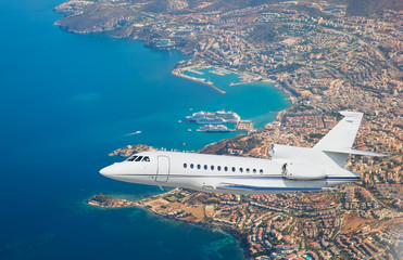 Luxury design private jet flying over the city