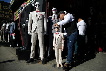 A man adjusts a mannequin in downtown Los Angeles