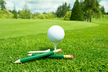 Golf Ball on Green grass with copy space for text