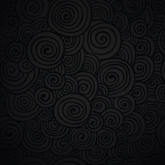 Black paper with a retro swirl pattern