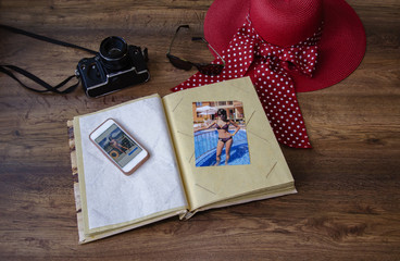 photo album with photo camera, phone