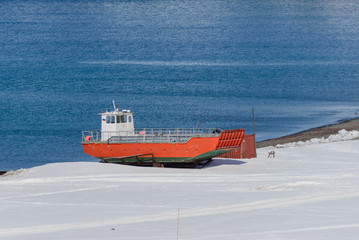 Papiers peints Antarctique Orange boat on shore near Bellingshausen Russian Antarctic research station