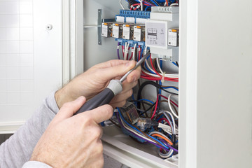 electrician at work on an electrical panel