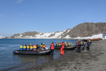 Deurstickers Antarctica Bellingshausen Russian Antarctic research station, King George island, Antarctica - December 28, 2015: Tourists ready for sail to vessel in inflatable boats