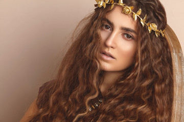 Wall Mural - Beautiful Woman. Curly Long Hair. Fashion Model. Healthy Wavy Hairstyle. Accessories. Autumn Wreath, Gold Floral Crown