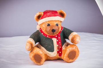 bear dressed for Christmas is taking a photo