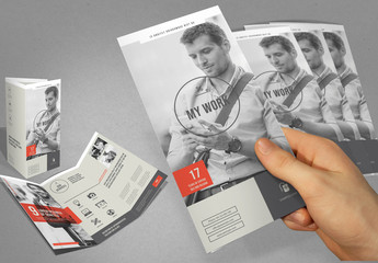Gray and White Trifold Brochure Layout with Red Accents