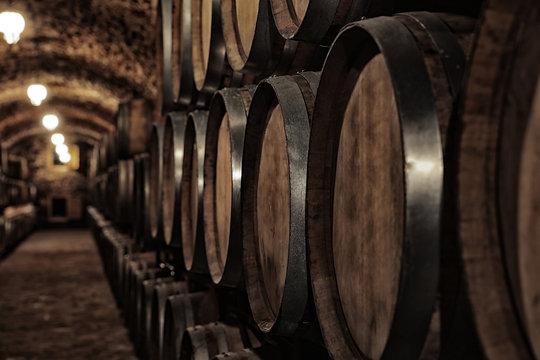 Large wooden barrels in wine cellar, closeup