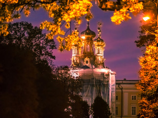 Saint Petersburg. Autumn. Russia. Pushkin City. Trees with red leaves. Tsarskoe Selo. Museums of St. Petersburg. Sunset over the city of Pushkin.