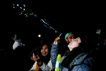A woman blows bubbles on the day Canada legalizes recreational marijuana at Trinity Bellwoods Park in Toronto
