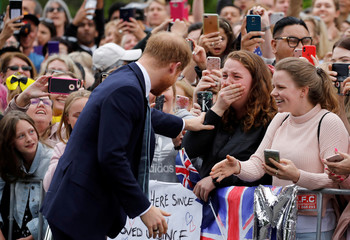 Britain's Prince Harry greets members of the public as he arrives at the Royal Botanic Gardens in Melbourne