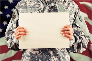 Young military man holding sign board