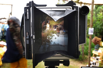 photographing a landscape on large format cameras with focusing screen . Effect vintage effect