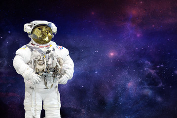 spaceman on space background.elements of this image furnished by NASA
