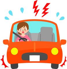 車の中で慌てる運転中の女性