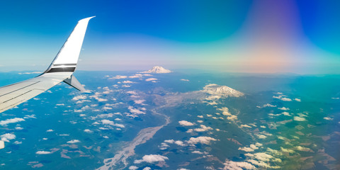 Mount Rainier's white peaks seen from an airplane