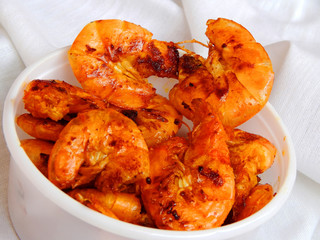 Fried tiger prawns in a white bowl. Shrimp salad