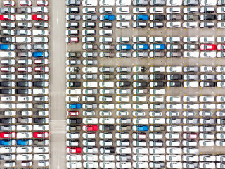 Bird's-eye view photo from flying drone, New Cars produced Several times a year at industrial estate for import export around in the world