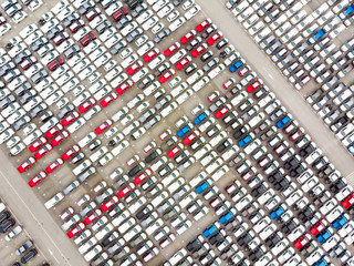Aerial top view photo from flying drone, New Cars produced Several times a year at industrial estate for import export around in the world