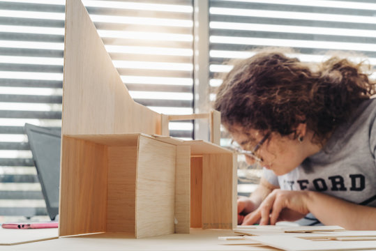 A Woman architecture student working on models