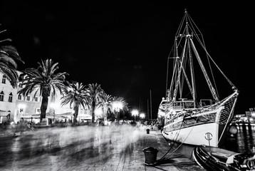Promenade in harbor, Trogir, Croatia, colorless