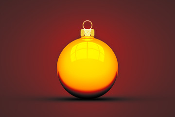 yellow Christmas ball isolated on red background