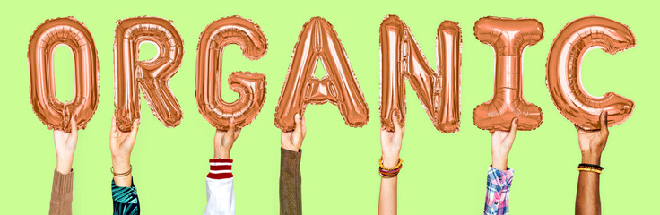Hands showing organic balloons word