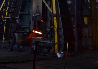 Heavy industry metallurgical plant sparks stove metall. Plant for the production of steel. Factory worker takes a sample for metal. Smelting of the metal in the foundry