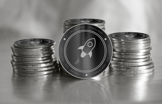 Stellar (XLM) digital crypto currency. Stack of black and silver coins. Cyber money.