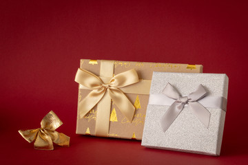 Christmas decoration with two gift boxes on red background