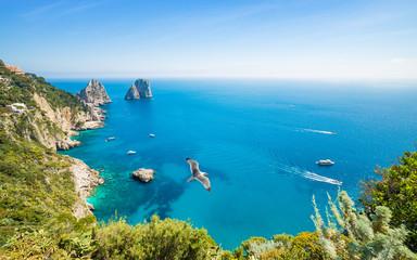 Daytime aerial view of famous Faraglioni rocks near Capri island, Italy