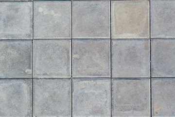 Grey square stone ground paving texture and background
