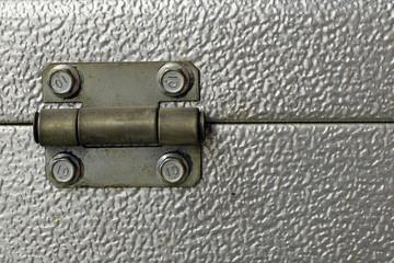 Close up of roller garage door hinge. Copy space.
