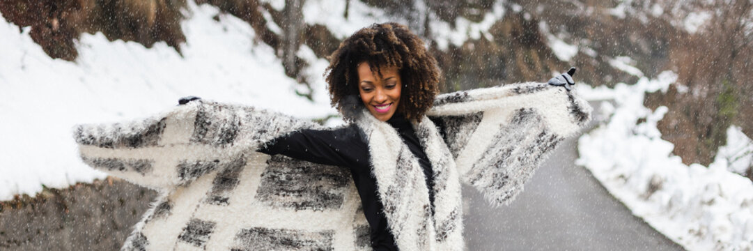 Joyful woman in winter outdoor