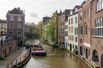 View on canal and houses in Utrecht The Netherlands with garbage collection service by boat