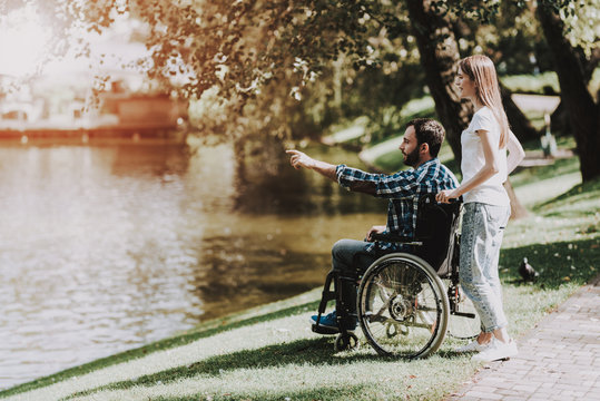 Disabled Man on Wheelchair with Girlfriend in Park