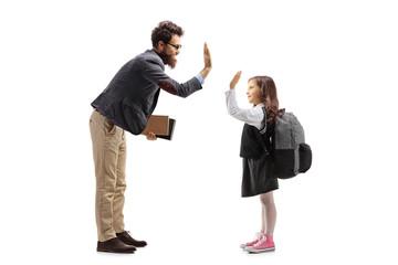 Teacher high-fiving a schoolgirl