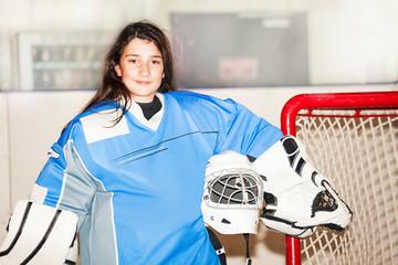 Happy girl goaltender posing after hockey match