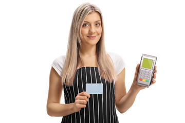 Waitress holding a credit card and a payment terminal