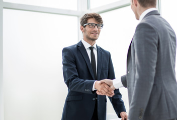 welcome handshake of business partners in the office.