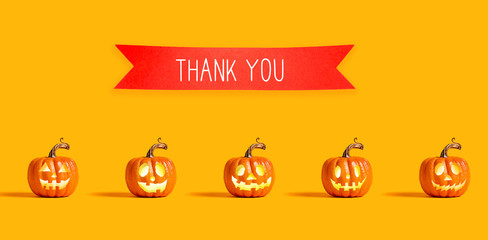 Thank you message with orange pumpkin lanterns with a red banner