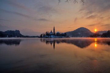 Lake Bled with the church during winter morning.