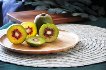 Plate of Fresh Red Kiwifruit on Table