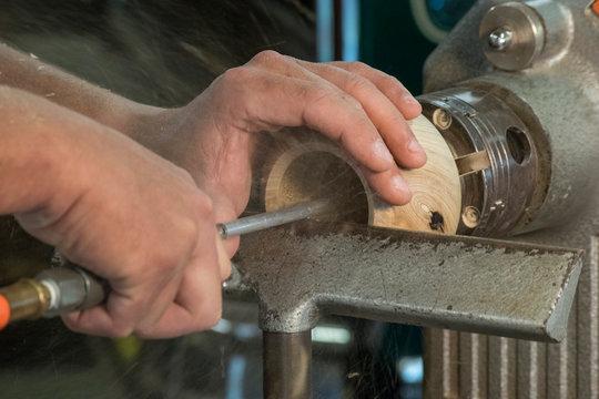 man making wooden bowl