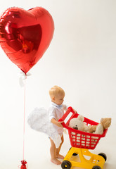 valentines day and love. little boy go shopping with full cart. savings on purchases. little boy child in toy shop. shopping for children. happy childhood and care. Male shopping. Pleasant price